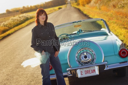 woman with vintage car