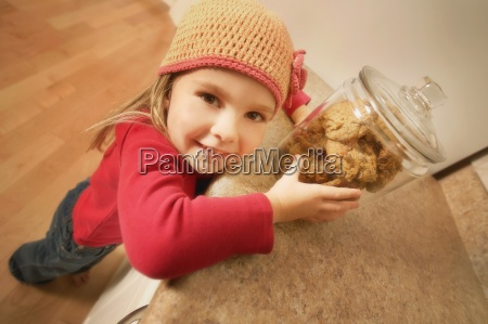 child with cookie jar