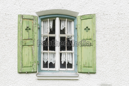 window with shutters on an old