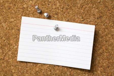 index card on a bulletin board