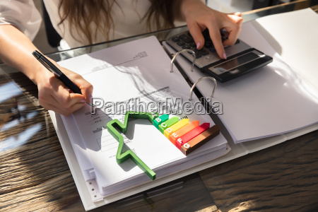 woman calculating energy efficient house