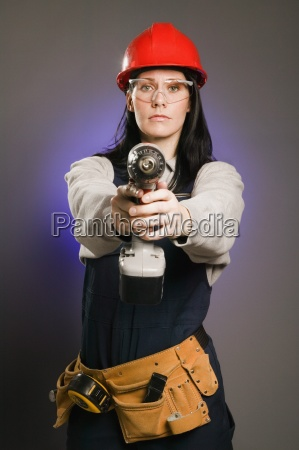 tradeswoman armed and dangerous with power