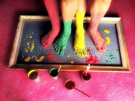 painted bare feet standing on a