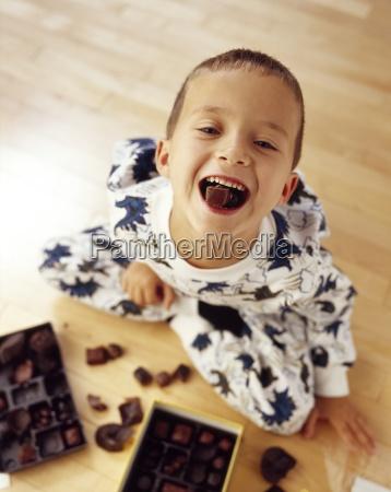 a boy eating chocolates