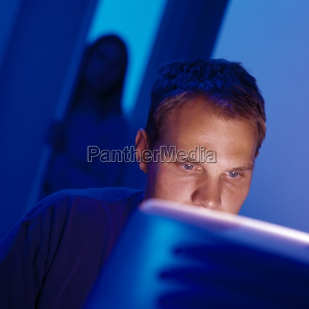 man working at computer with woman