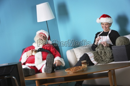 santa and mrs claus relaxing