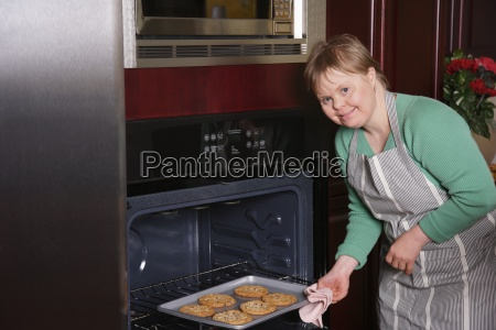 woman with down syndrome making freshly