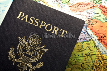 american passport laid over a map