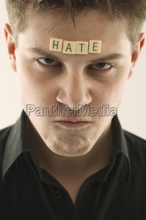 man with the word hate spelled