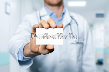 doctor showing blank business card