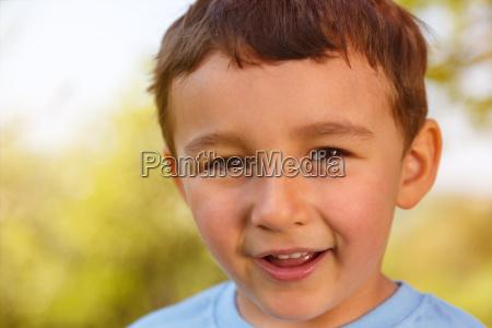 child young boy portrait face laugh