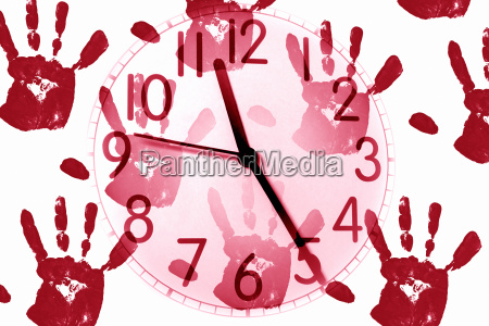 clock on handprint background