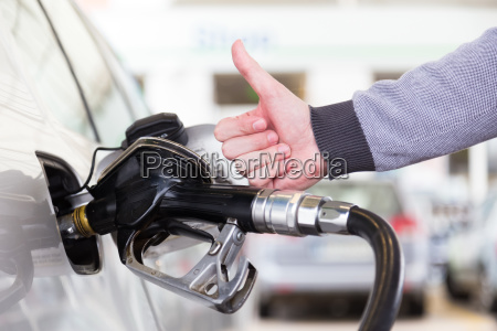 petrol or gasoline being pumped into