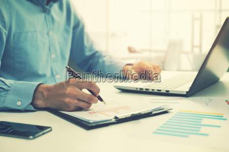 businessman analyzing annual business report and