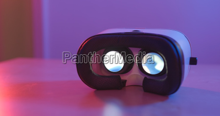 holding virtual reality device with pink