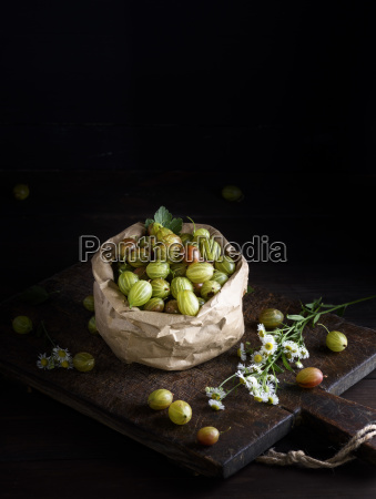 ripe green gooseberry in a paper