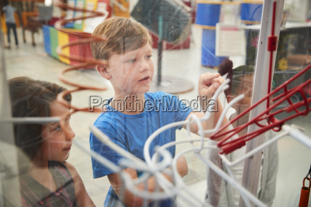 kids looking through glass at a