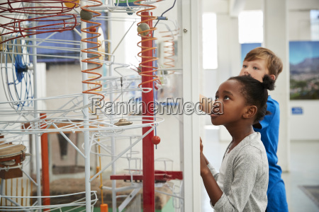 two kids looking at a science