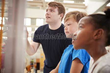 teacher and kids looking at a