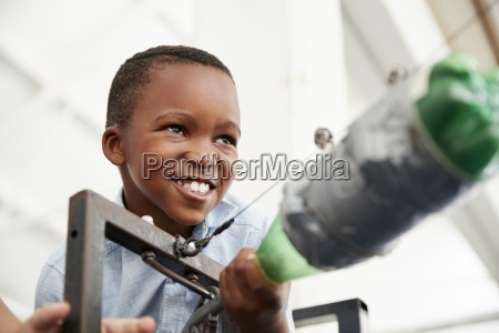 young black boy using air pressure
