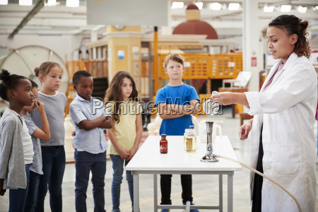 kids watching lab technician carry out