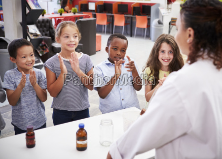 classmates applauding teacher after a science
