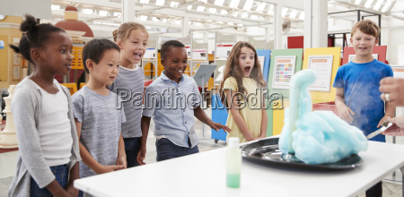 kids having fun watching an experiment
