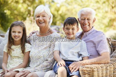 grandparents and grandchildren sitting in the
