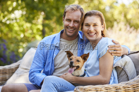 happy young couple sitting with