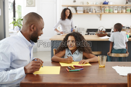 young black family of four busy