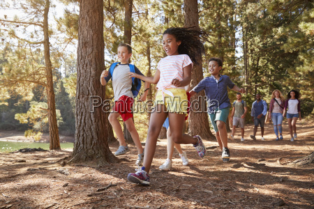 children running ahead of parents on