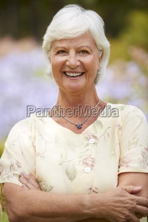 portrait of senior woman enjoying walk