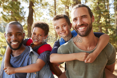 portrait of boys with fathers on