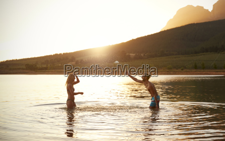 couple enjoying evening swim in countryside