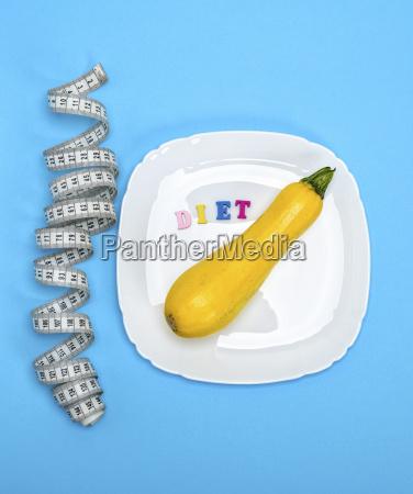 yellow raw squash lies in a