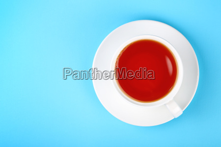 white cup of black or red