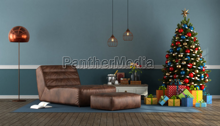 blue living room with christmas tree