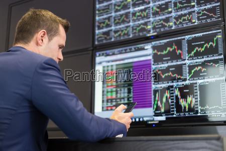 stock trader looking at market data