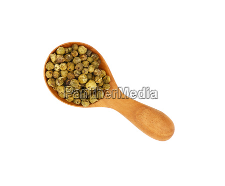 wooden scoop spoon full of green