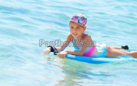 happy girl on bodyboard