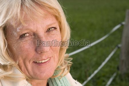 smiling blonde mature woman