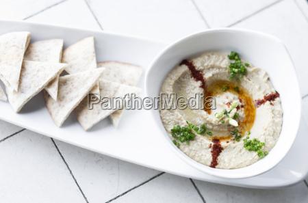 organic hummus dip and pita bread