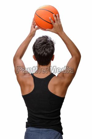 teen sportsman with sportswear playing basketball