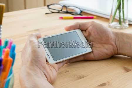 smartphone or mobile phone on hand