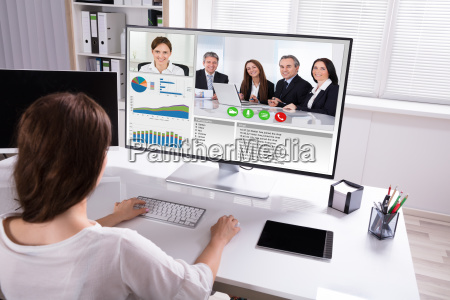 businesswoman video conferencing with colleagues on