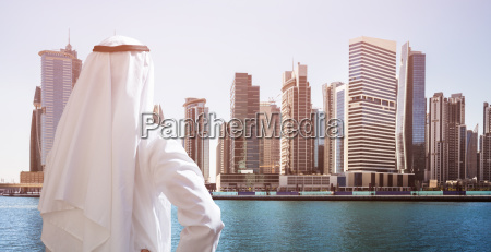 man standing in front of dubai