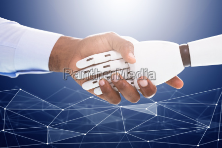 robot and businessman shaking hands