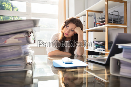 stresses businesswoman sitting in office