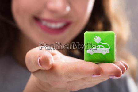 woman holding cubic block with electric