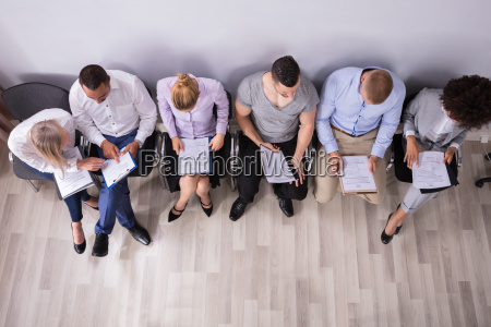 row of people waiting for job